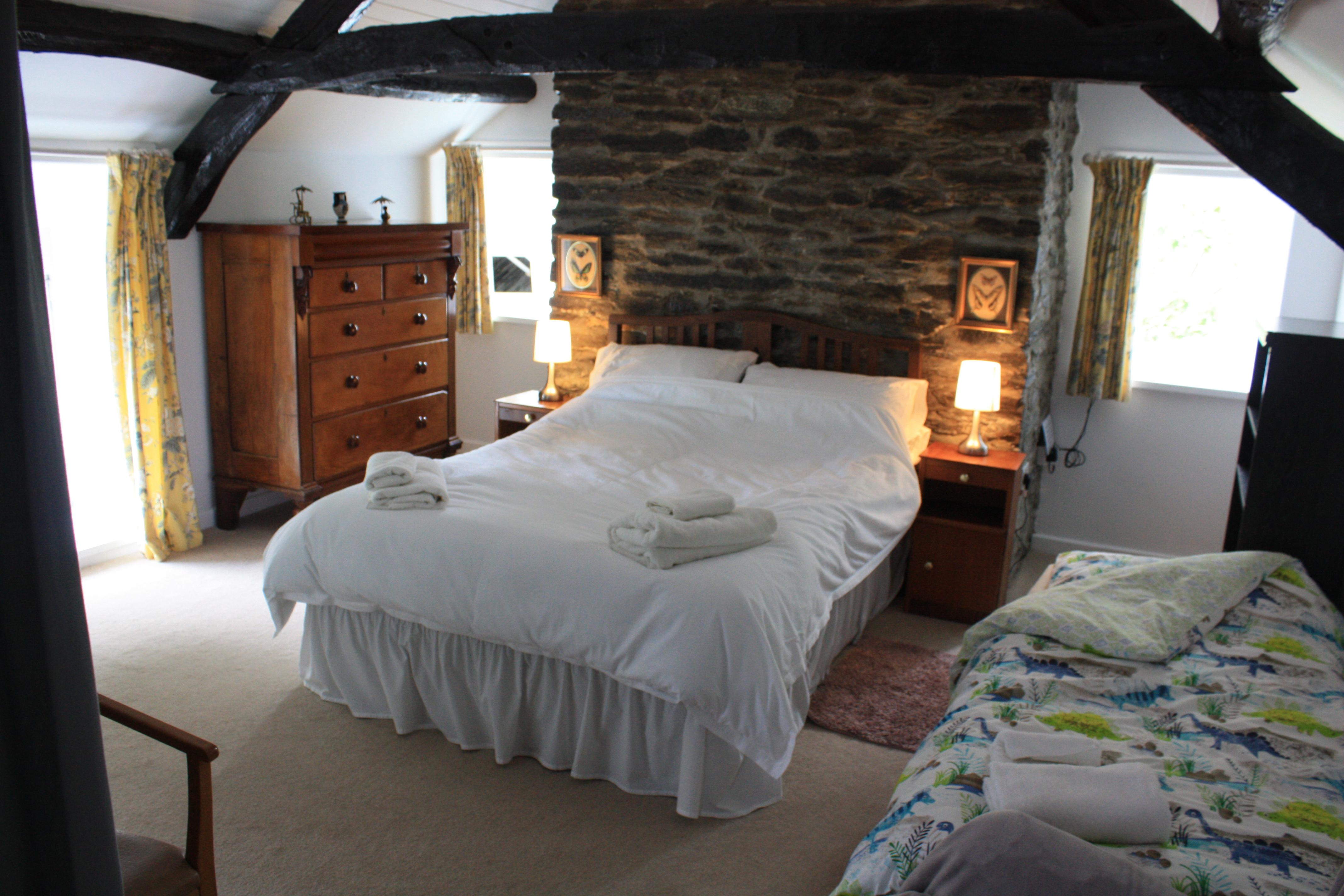 Bedroom, with original beams at The Old Vicarage, Llangeler
